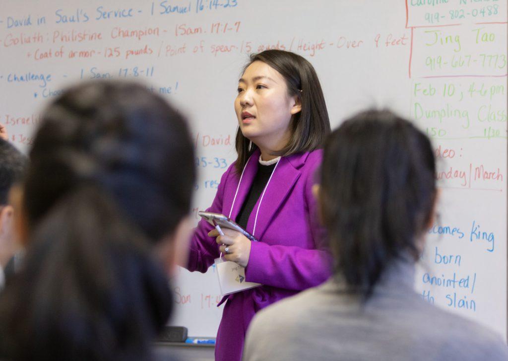 A photo of a woman teaching